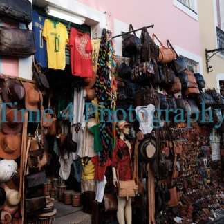 Small shop on the street of Salvador, Brasil, selling several different typical souvenirs like leather hats, bags, t shirts etc