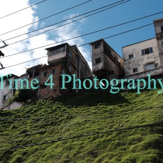 Slum on a hill,in the city of Salvador da Bahia, Brazil. The photo was taken from the street and the sky is blue and cloudy.