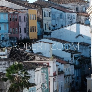 A cluster of colonial houses in different colors, at the historic area of Salvador da Bahia, Brasil