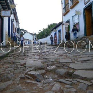 An old stone paved street with two rows of houses from the colonial period, in Tiradentes, Brasil