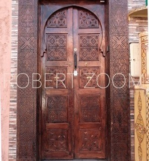 A fine chiseled wooden door in Marrakech, Morocco