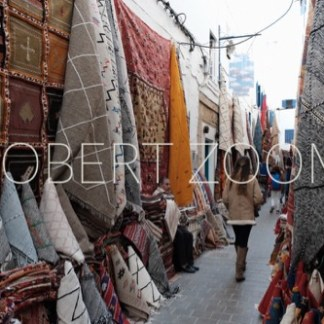 Wonderful oriental rugs shown along an alley in Marrakech