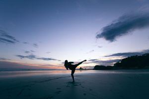 Yoga silhouette on beach
