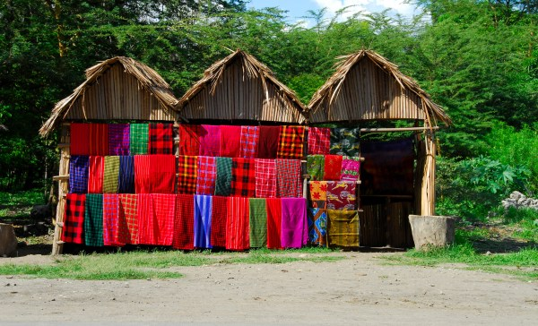 Shop-with-traditional-multicolored-Masai-blankets-along-the-road,Tanzania-000002831657_Large