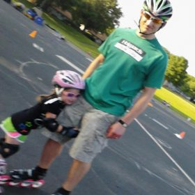 Andy Kostka with Brynn Kostka in Preschool Inline Skate Class at Maple Grove.