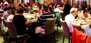 Family-style dining enhances the sense of community for The Farmers Dinner.
