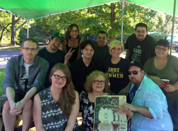Some of the original reality panel members at the 20th reunion, holding one of Dan's cover stories.