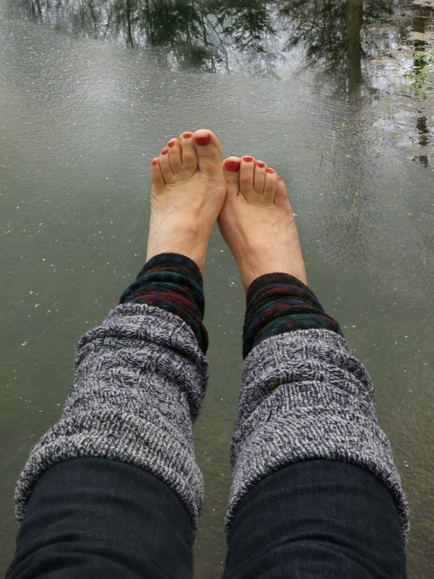 In Ithaca, New York, Robin Botie swings her red-painted toes out over the pond