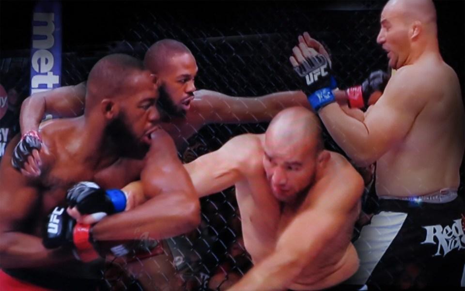 Robin Botie of Ithaca, New York, photoshops Jon Bones Jones on TV defending his title at UFC 172 main event in Baltimore