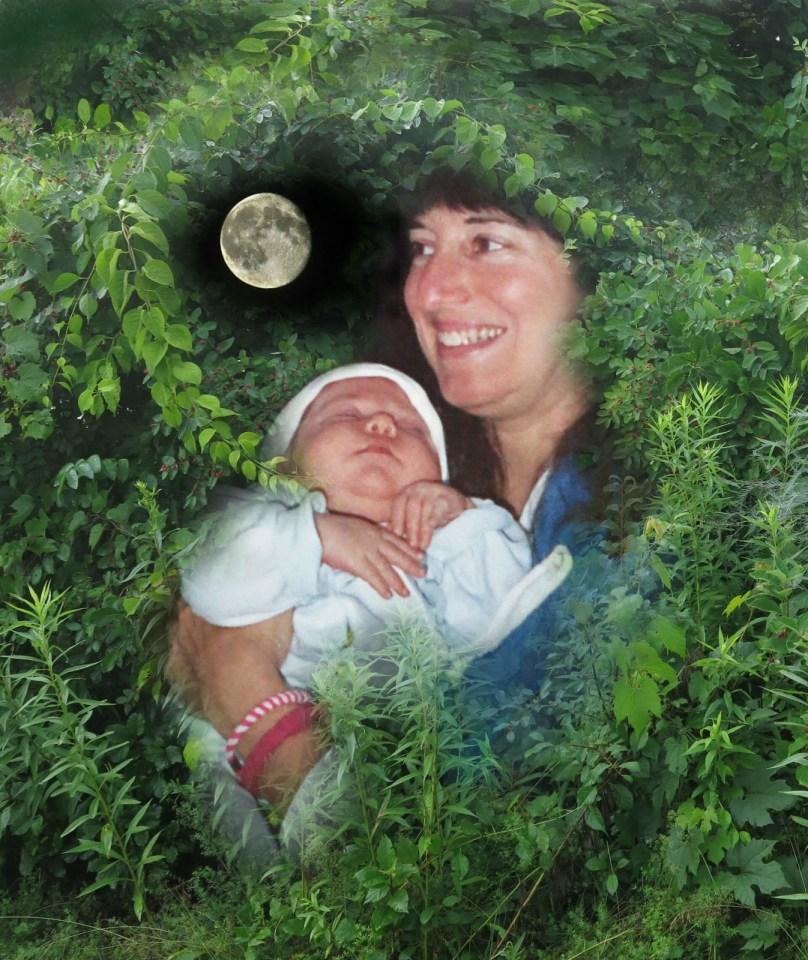 Robin Botie in Ithaca, New York, holds newborn Marika Warden like she is holding the moon.