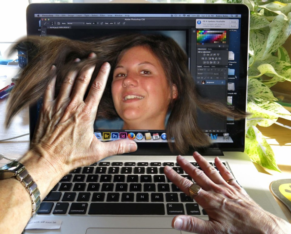 Robin Botie in Ithaca, New York, hovers over computer screen showing her daughter, Marika Warden, who died of leukemia at the age of 20.