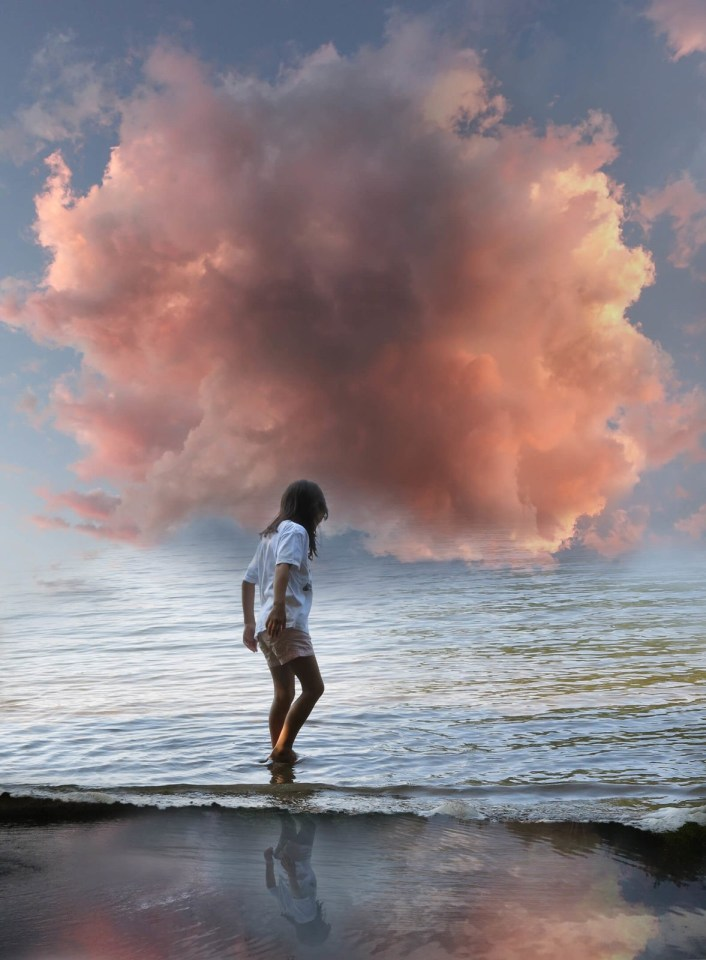Robin Botie of Ithaca, New York, in a quest for joy, photoshops a lone girl with her head in a pink cloud.