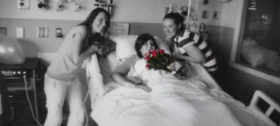 Robin Botie of ithaca, New York, restores a photograph of her daugher with two oncology nurses at Strong Memorial Hospital.