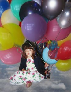 Robin Botie in Ithaca, New york, Photoshops her daughter who died of leukemia as a young girl surrounded by balloons
