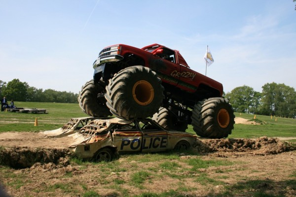 Driving over a police car in a monster truck