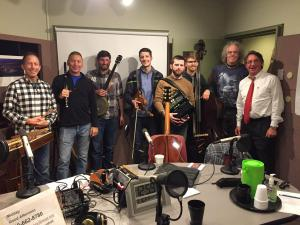 Members of Helicon and Charm City Junction join Tom Hall in WYPR's Studio A before their 2016 Winter Solstice Concert: (l-r) Ken Kolodner, Chris Norman, Brad Kolodner, Patrick McAvinue, Sean McComiskey, Alex Lacquement, Robin Bullock, Tom Hall.