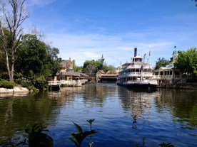 The Liberty Square Riverboat sits quietly on the Rivers of America, waiting to take a trip around Tom Sawyer Island. While she looks the same as Disneyland's Mark Twain Riverboat … here name quite differently reflects her roots in Liberty Square.