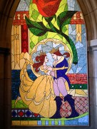Inside the restaurant is a happily-ever-after stained glass of Belle and her Prince.