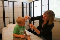 Child having acupuncture