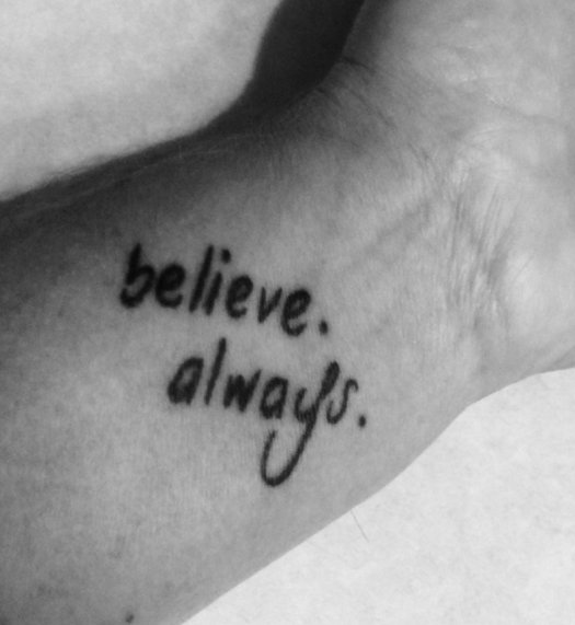 Tattoo on a wrist, black and white photo