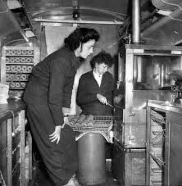Black and white photo of women baking dougnuts, circa 1940s