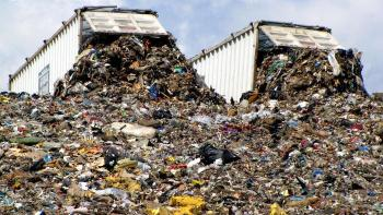 landfill with two trucks