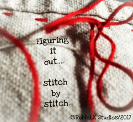 Red yarn stitched into fabric with a quote