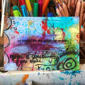 Image of artist's postcard and art supplies