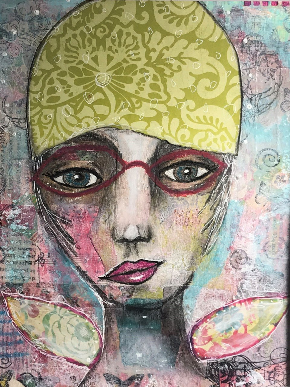 mixed media art of a woman's whimsical face with red glasses and green swim cap