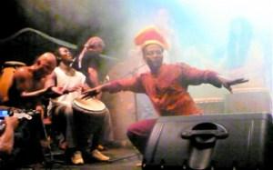 Akim Funk Buddha dancing while members of various bands jam together