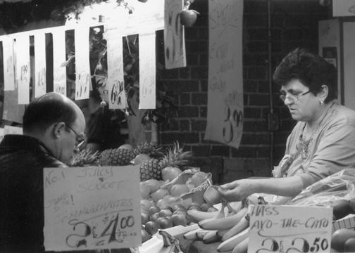 Produce shop owner at St. Lawrence Market