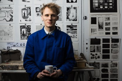 Posing in the studio, in front of the series