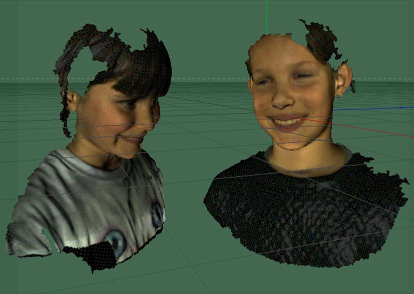 Schermafbeelding van 3D-scans van twee kinderen in een CAD–programma.