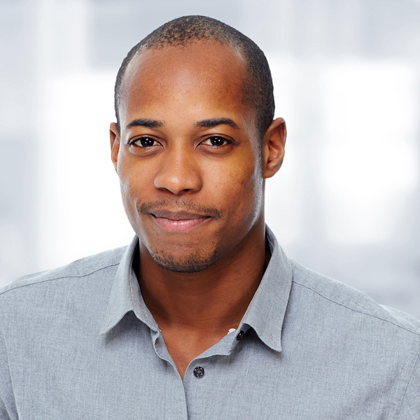 Young man in smart shirt smiling
