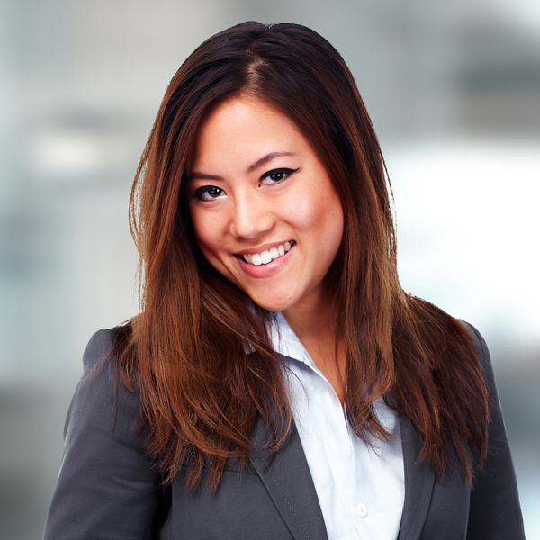 Asian woman in business suit smiling 2