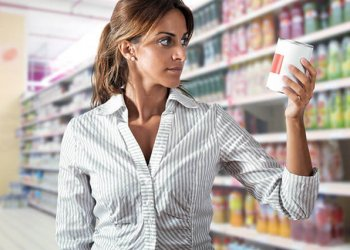 Woman looking at products in shopping aisle