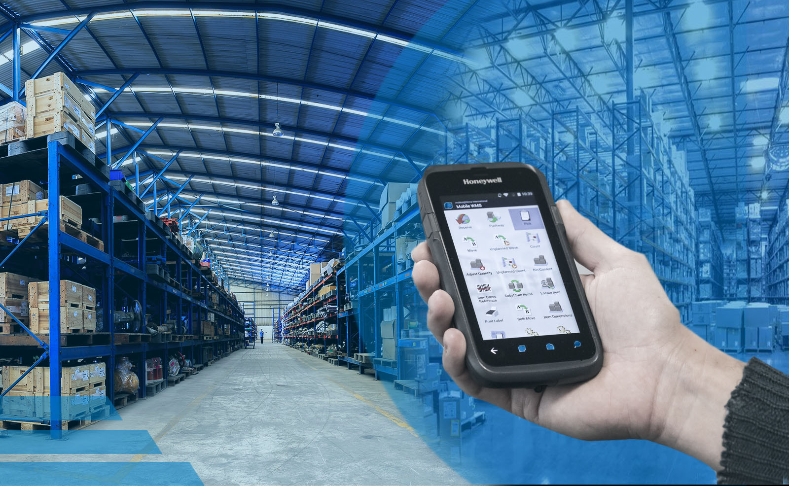 Warehouse with man holding mobile phone with apps