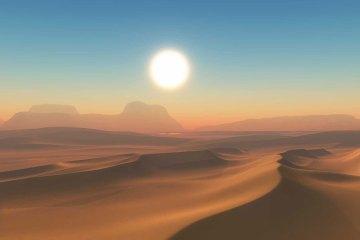 Brandende zon boven de woestijn