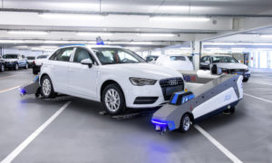 A Ray robot, made by Serva Transport Systems, picks up and moves an Audi car at its Ingolstadt plant