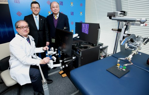 Prof Law (left), Prof Yeung (middle) and Prof Yung (right), with their single incision or natural orifice (incision-less) robotic surgery system