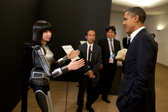 president_barack_obama_observes_the_cybernetic_human_robot_prior_to_the_start_of_the_apec_dinner_at_the_pacifico_yokohama_conference_center_in_yokohama