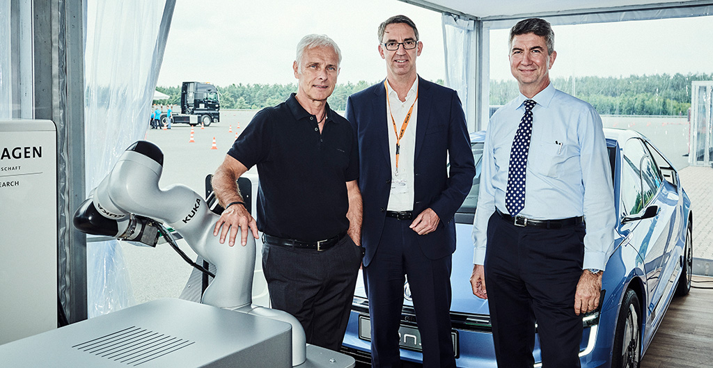 From left: VW CEO Matthias Müller, CEO of Kuka, Till Reuter, and head of R&D at VW Group Ulrich Eichhorn