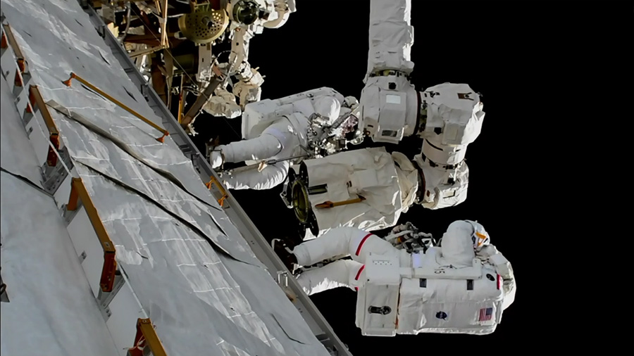 Nasa astronauts carry out maintenance work on robotic arm on the International Space Station