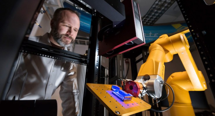 Sandia's robotic work cell conducts high-throughput testing 'in an instant'