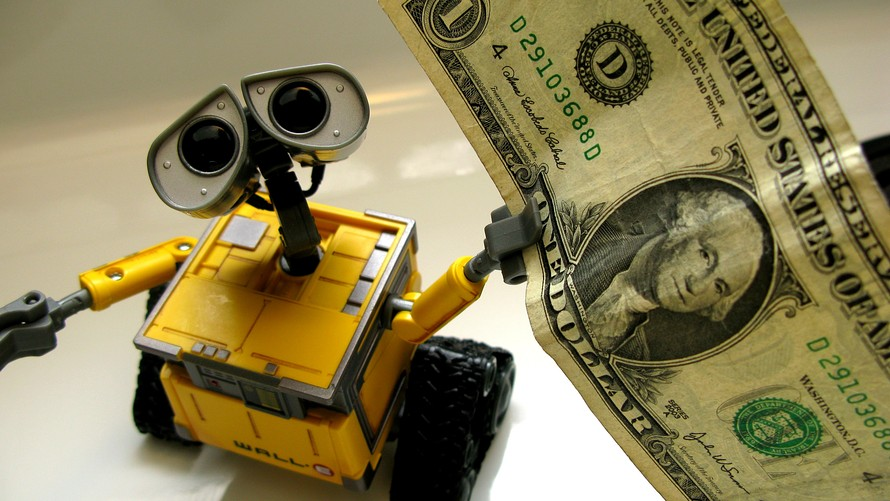 robot with dollar bill