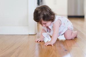 Baby on hardwood floor