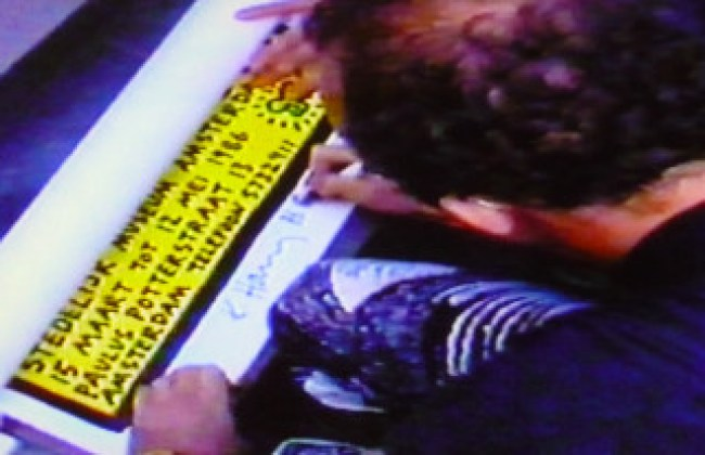 Keith Haring signing a poster after his lecture and tv-interview, Stedelijk Museum, Amsterdam, 15 March 1986, local TV (foto Chris Reinewald)