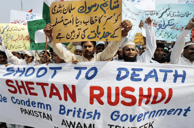 Ten years after its publication, hundreds of Islamists burn effigies of Rushdie in Pakistan as parliament renews call for Britain to withdraw novelist's knighthood (Aamir Qureshi:AFP)