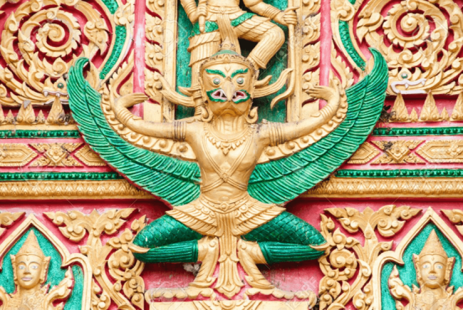 The Garuda is a large mythical bird, bird-like creature, or humanoid bird that appears in both Hindu and Buddhist mythology (foto Stock Photo)