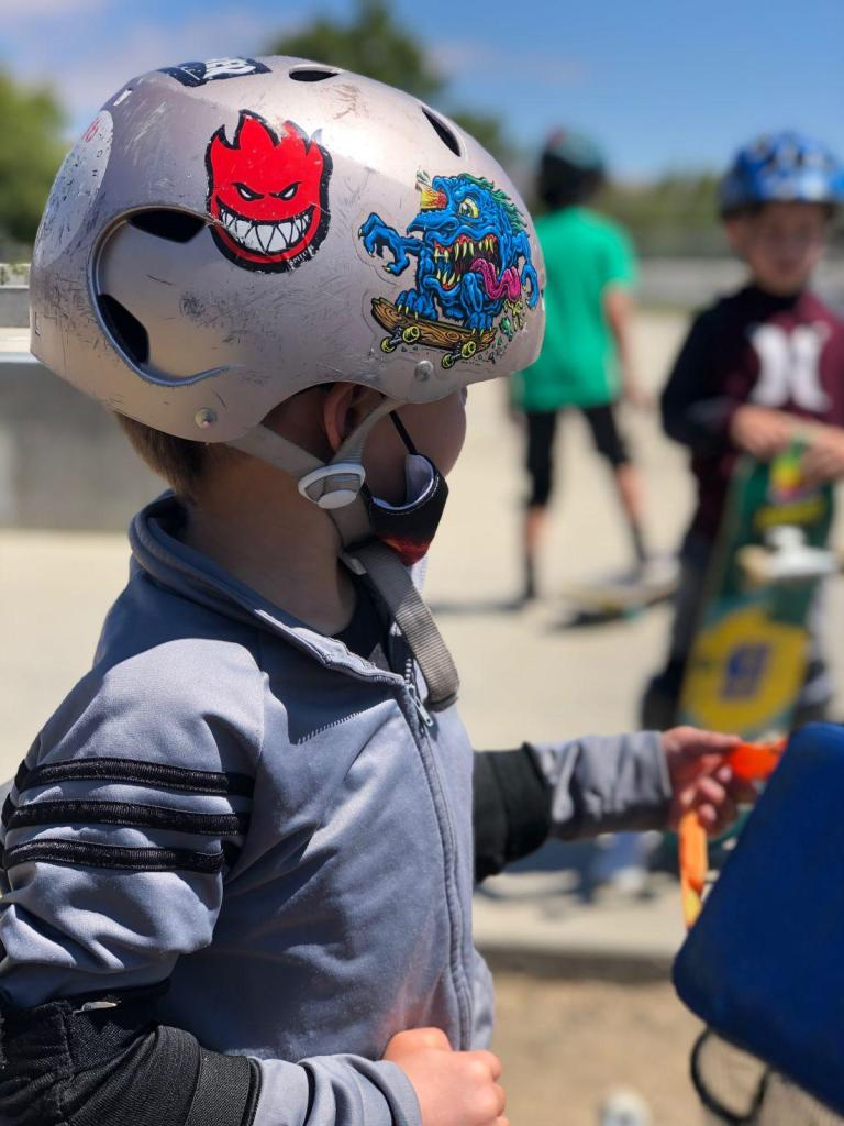 Kid using a helmet at Rob Skate academy